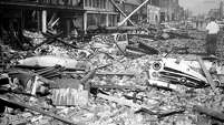 ** FILE ** Buried automobiles lie under bricks from downtown stores along Franklin Street in downtown Waco, Texas, in this May 11, 1953 file photo. The unexpected storm killed 114 people and damaged 200 business. Sunday, May 11, 2003, marks the 50th anniversary of the deadly tornado. Photos from the tornado are on exhibit at the Dr Pepper museum which was also damaged during the storm. (AP Photo/Dr Pepper Museum, Jimmie Willis, HO)  HOUCHRON CAPTION (05/11/2003-2-STAR): Automobiles lie under bricks in downtown Waco after a tornado killed 114 people and damaged 200 businesses on May 11, 1953. Photos are on exhibit at the Dr Pepper Museum in Waco.