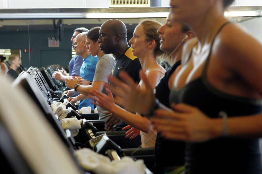 For safety's sake, try to ignore the TVs and everyone around you when using a treadmill. Photo: HIROKO MASUIKE, STF / NYTNS
