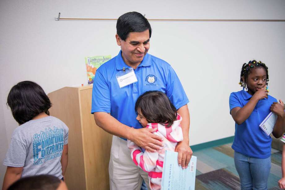 "Converse Mayor Al Suarez receives a hug from first grader Valerie Coyle after Suarez read to her class on Friday, May 8, 2015. Mayor Suarez served as ""principal for a day"" at Copperfield Elementary School, which opened its doors this year. ""I'm very thankful for what the district did for me so I'm trying to give back,"" Suarez said. Suarez's son graduated from Judson Early College Academy and is set now to graduate this year from UT in Austin, where he was able to enroll as a junior because of all his early college classes. Photo: Matthew Busch, For San Antonio Express-News / For San Antonio Express-News / © Matthew Busch"