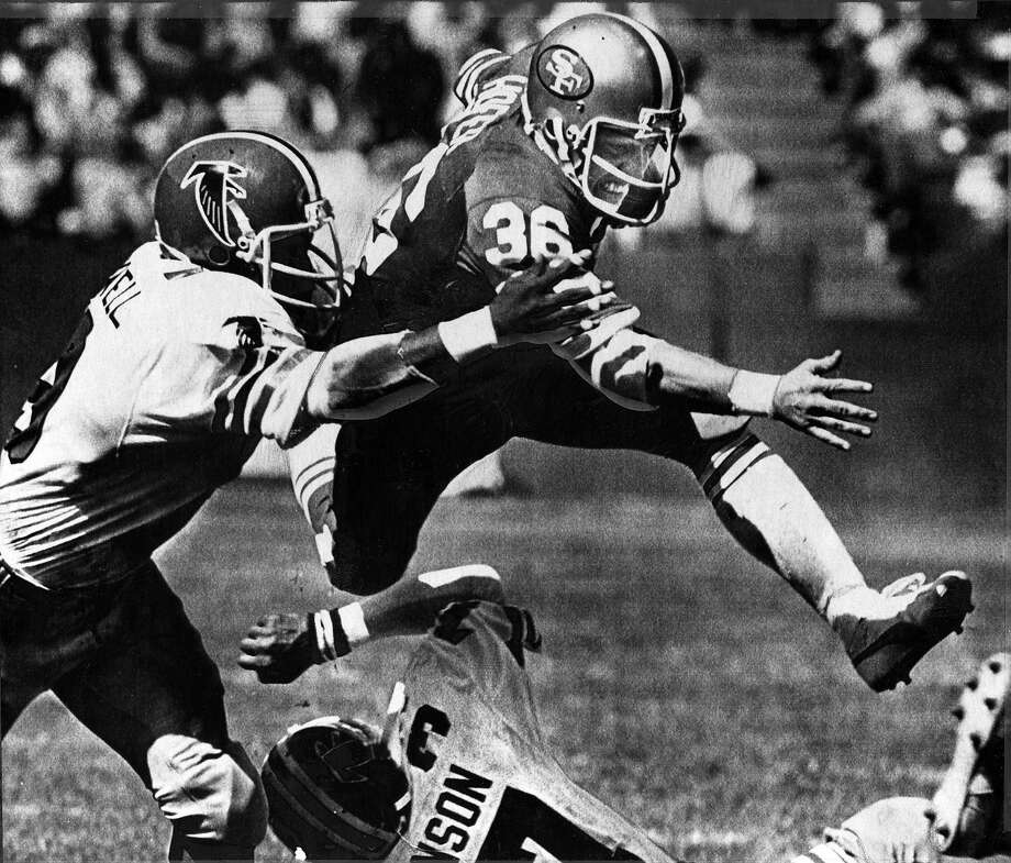Running back Paul Hofer leaps over a would-be tackler as he heads toward the goal line during a Sept. 29, 1980, game against the Atlanta Falcons at Candlestick Park. Photo: Associated Press