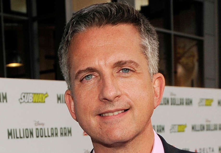 """FILE - In this May 6, 2014 file photo, Bill Simmons arrives at the world premiere of """"Million Dollar Arm"""" at El Capitan Theatre in Los Angeles. ESPN says that it is parting ways with Bill Simmons, one of its top personalities who created the Grantland website and was instrumental in the network's documentary series. Network president John Skipper said Friday that he decided not to renew Simmons' contract.  (Photo by Chris Pizzello/Invision/AP, File) Photo: Chris Pizzello / Associated Press / Invision"""