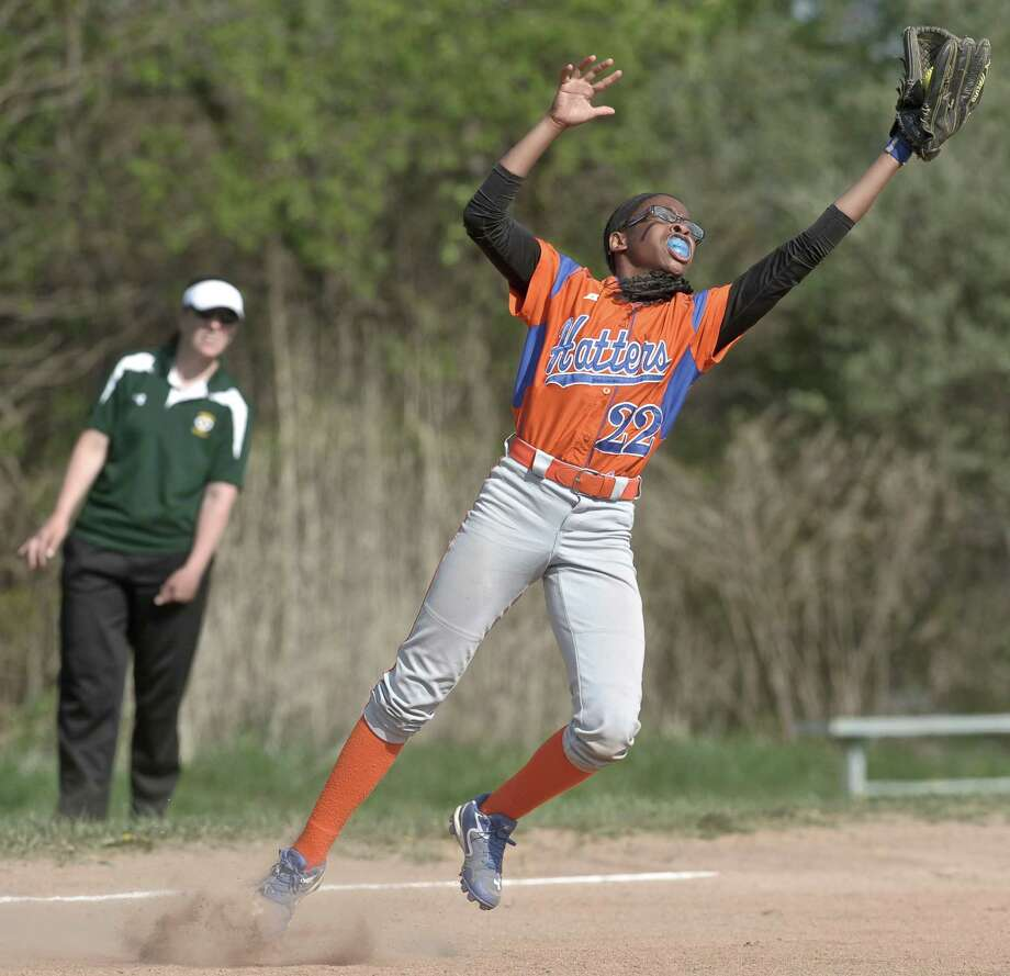 Danbury's Davonna Spruill (22) catches a pop up bunt during the girls high school softball game between Trinity Catholic and Danbury high schools on Friday, May 8, 2015, played at Danbury High School, in Danbury, Conn. Photo: H John Voorhees III / The News-Times