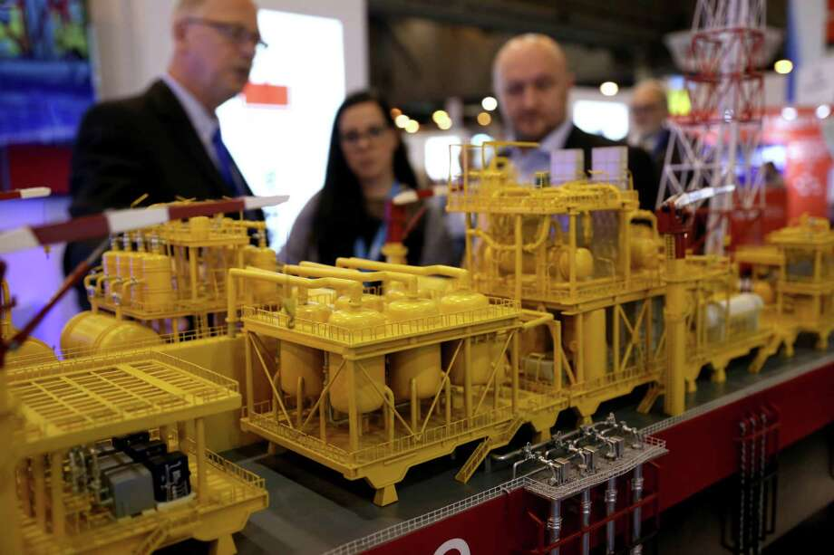 A scale model of an offshore rig draws visitors at the Offshore Technology Conference at the NRG Center. The conference draws industry members from around the globe. ( Gary Coronado / Houston Chronicle ) Photo: Gary Coronado, Staff / © 2015 Houston Chronicle