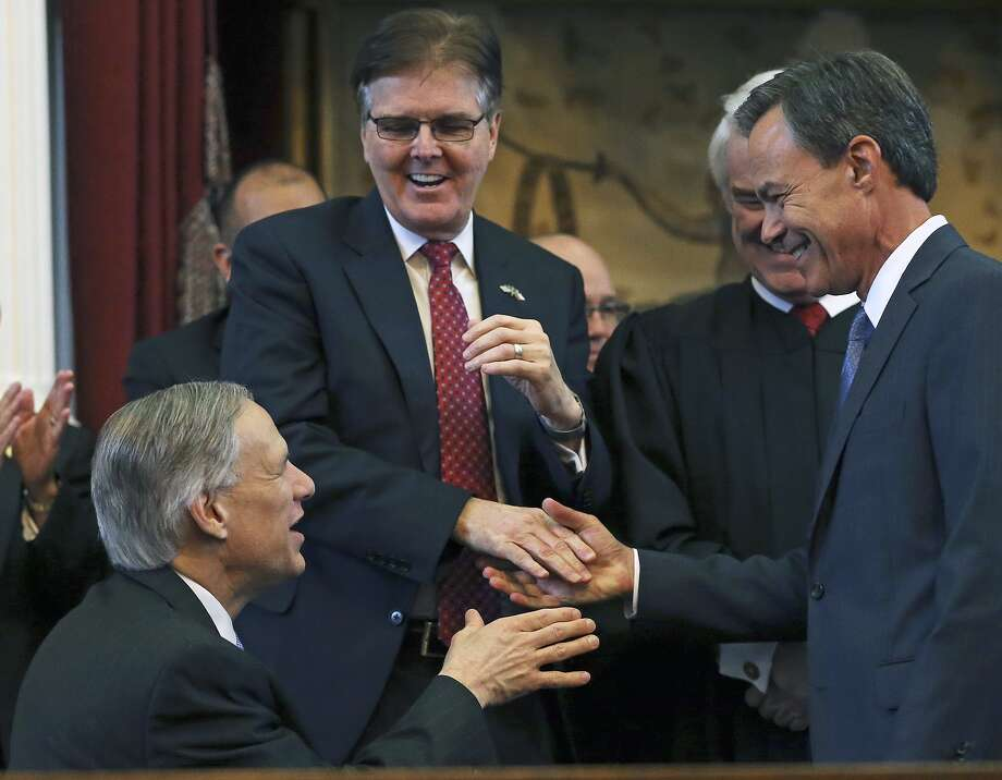 Governor Greg Abbott, left, fulfilled his promise to sign into law a measure barring local fracking bans after it passed the Senate, led by Lt. Gov. Dan Patrick, center, and the House, led by Speaker Joe Straus, right. Photo: Tom Reel
