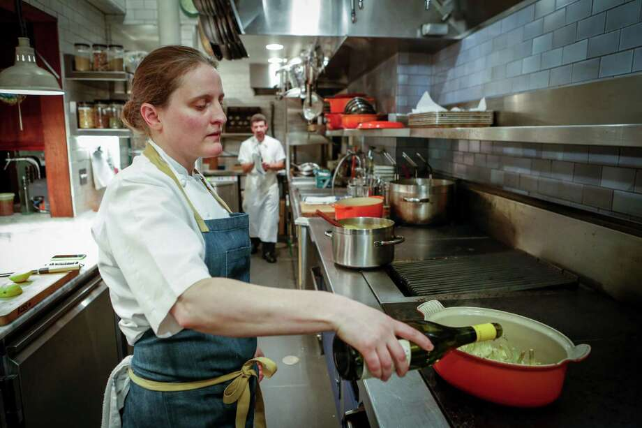 "Chef April Bloomfield, chef and co-owner of Tosca Cafe, makes Pot-Roasted Artichokes, a recipe from her book ""A Girl and Her Greens."" Photo: Russell Yip / The Chronicle / ONLINE_YES"