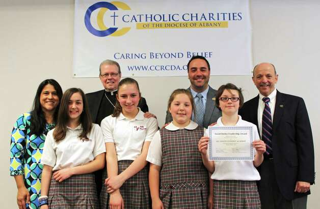 Albany Roman Catholic Diocese students were honored for contributions to the Rice Bowl collection, a Lenten appeal to fund food, shelter, and education programs throughout the world. In back row from left are Mari Barboza, Catholic Relief Services; Bishop Edward Scharfenberger; Michael Pizzingrillo, Superintendent of Catholic Schools and Vincent W. Colonno, CEO of Catholic Charities. Students are, from left eighth-graders Rosemary Macri and Caterina Reish and fifth-graders Sophia Lucarelli and Alexis Coffey. (Paul McAvoy)