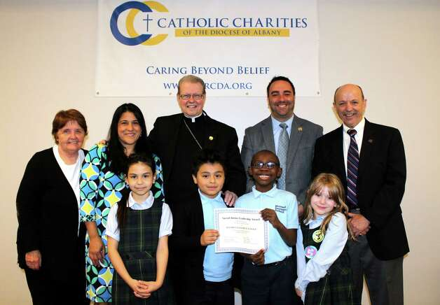 Students in the Albany Roman Catholic Diocese were honored for contributions to the Rice Bowl collection, an annual Lenten appeal to fund food, shelter, and education programs throughout the world. On April 30, Bishop Edward B. Scharfenberger joined with Vincent W. Colonno, CEO of Catholic Charities, Michael Pizzingrillo, superintendent of the Albany Diocesan Catholic Schools and Mari Barboza, Catholic Relief Services Northeast Region, to thank local students.