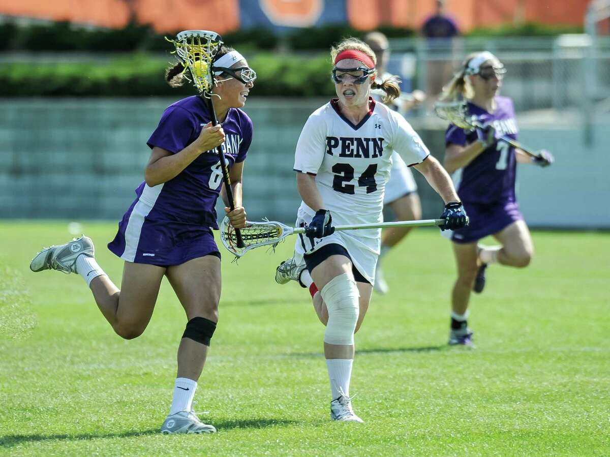 Rachel Bowles looks up the field against Penn during their NCAA Tournament game Friday in Syracuse. Bowles had three goals and two assists for the Danes in their 11-10 loss in double overtime at SU Soccer Stadium in Syracuse. (Bill Ziskin / Special to the Times Union)