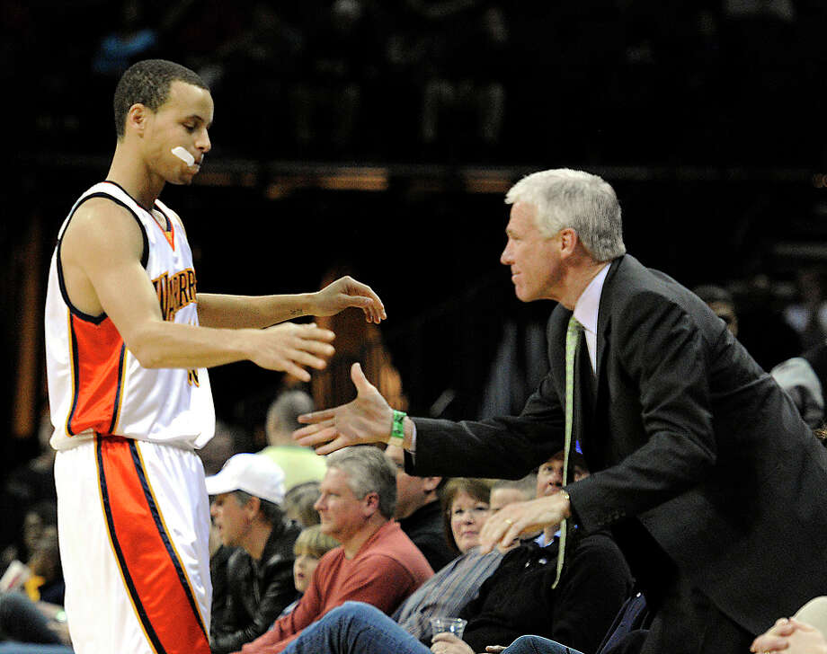 Warriors guard Stephen Curry remains close with his college coach, Davidson's Bob McKillop (right). Photo: DAVID T. FOSTER III / David T. Foster III / Charlotte Observer 2010 / Charlotte Observer