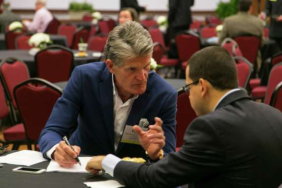 Helge Haldorsen, an executive of the Norwegian oil company Statoil and host of the Offshore Technology Conference's d5 event Friday, visits with one of the 280 attendees.   Photo by Todd Buchanan/Â Offshore Technology Conference