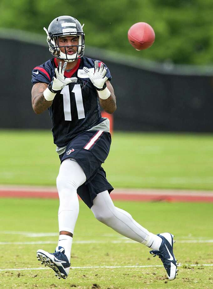 Rookie wide receiver Jaelen Strong keeps his eyes on the ball during the first workout of the Texans' rookie minicamp Friday at the Methodist Training Center. Photo: Brett Coomer, Staff / © 2015  Houston Chronicle