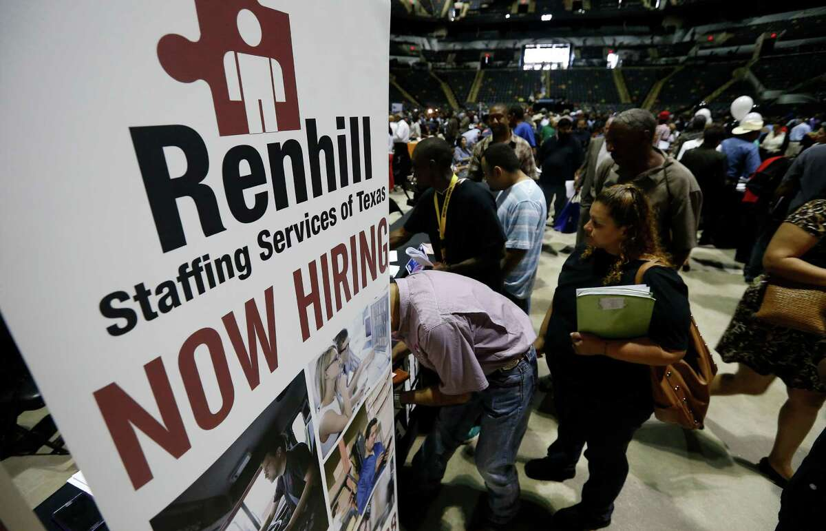 A small crowd waits to talk with staff at Renhill Staffing seeking work at the second chance job fair hosted by Bexar County Commissioner, Precinct 4 Tommy Calvert at the AT&T Center on Thursday, May 7, 2015. About 70 exhibitors and about 1,000 applicants were present at the three-hour long event.