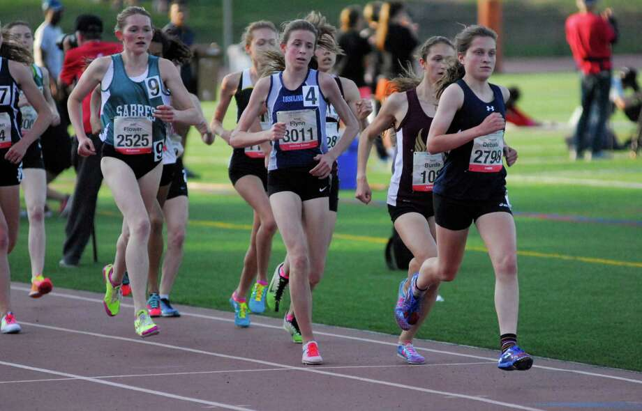 Staples junior Hannah DeBalsi, right, leads the pack in the 3,200 meter run at the Glenn D. Loucks games in White Plains, New York. DeBalsi finished second in the race. Photo: Ryan Lacey/Staff Photo / Westport News Contributed