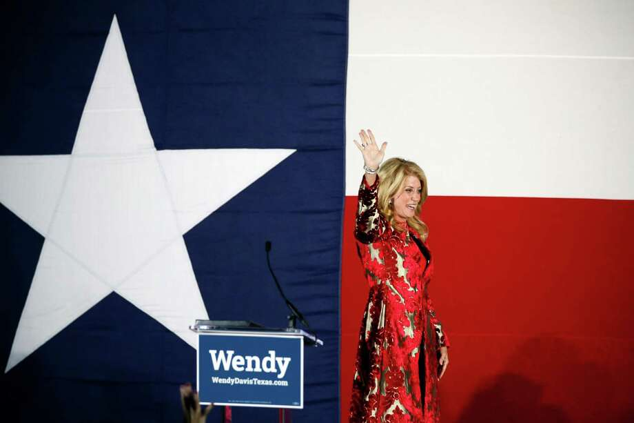 Texas Democratic gubernatorial candidate Wendy Davis waves to supporters as she leaves her election watch party after making her concession speech, Tuesday, Nov. 4, 2014, in Fort Worth, Texas. (AP Photo/Tony Gutierrez) Photo: Tony Gutierrez, STF / Associated Press / AP