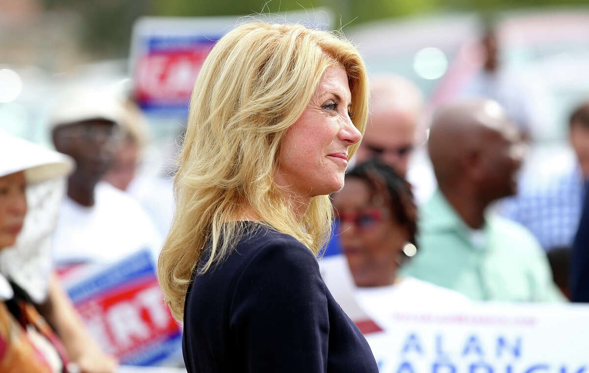 Wendy Davis stops to campaign stump with Tommy Calvert at the Claude Black Center on the East Side on October 28, 2014.