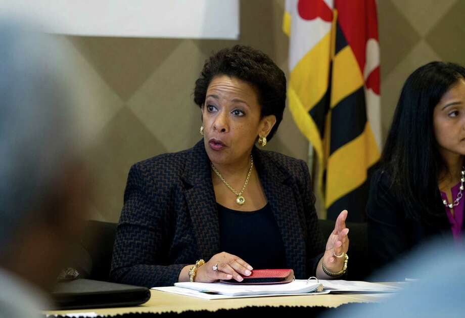 Attorney General Loretta Lynch speaks with members of Congress and faith leaders at the University of Baltimore on Tuesday, May 5, 2015, in Baltimore.  Lynch met with the family of Freddie Gray in private earlier. The FBI and the Justice Department are investigating Gray's death for potential civil rights violations. (AP Photo/Jose Luis Magana, Pool) Photo: Jose Luis Magana, POOL / POOL AP