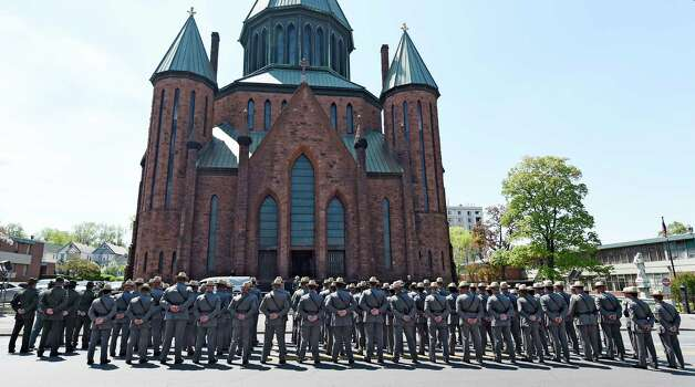 New York State Troopers line up for the funeral procession to leave the church as the ceremony for Thomas Constantine, former superintendent of the New York State Police's casket is moved from St. John the Evangelist Church Friday afternoon May 8, 2015 in Schenectady, N.Y.      (Skip Dickstein/Times Union) Photo: SKIP DICKSTEIN / 00031748A