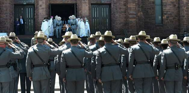 New York State Troopers salute as the funeral procession leaves the church after the funeral ceremony for Thomas Constantine, former superintendent of the New York State Police's leaves St. John the Evangelist Church Friday afternoon May 8, 2015 in Schenectady, N.Y.      (Skip Dickstein/Times Union) Photo: SKIP DICKSTEIN / 00031748A