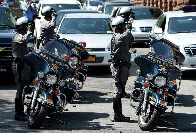 New York State Troopers salute as the funeral procession  leaves the church after the ceremony for Thomas Constantine, former superintendent of the New York State Police's casket is moved from St. John the Evangelist Church Friday afternoon May 8, 2015 in Schenectady, N.Y.      (Skip Dickstein/Times Union) Photo: SKIP DICKSTEIN / 00031748A