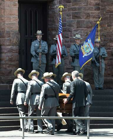 New York State Troopers carry the casket of Thomas Constantine, former superintendent of the New York State Police in to St. John the Evangelist Church Friday afternoon May 8, 2015 for the funeral ceremony in Schenectady, N.Y.      (Skip Dickstein/Times Union) Photo: SKIP DICKSTEIN / 00031748A