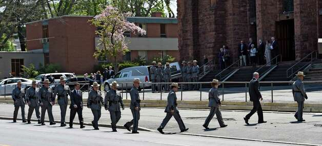 Members of the command staff of New York State Police  leaves St. John the Evangelist Church after the funeral ceremony for Thomas Constantine, former superintendent of the New York State Police Friday afternoon May 8, 2015 in Schenectady, N.Y.      (Skip Dickstein/Times Union) Photo: SKIP DICKSTEIN / 00031748A
