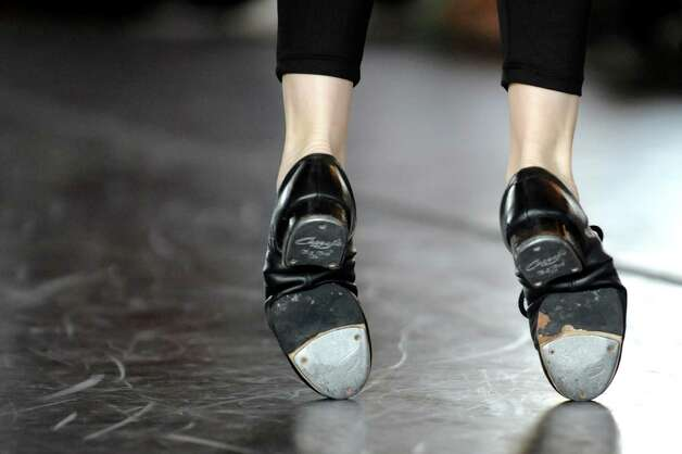 A tap dancer raises on her toes as she performs Rhythmic Warriors during the Steinmetz Symposium on Friday, May 8, 2015, at Union College in Schenectady, N.Y. Representing a variety of dance styles, more than 70 students performed as part of the Lothridge Festival of Dance. (Cindy Schultz / Times Union) Photo: Cindy Schultz / 00031764A