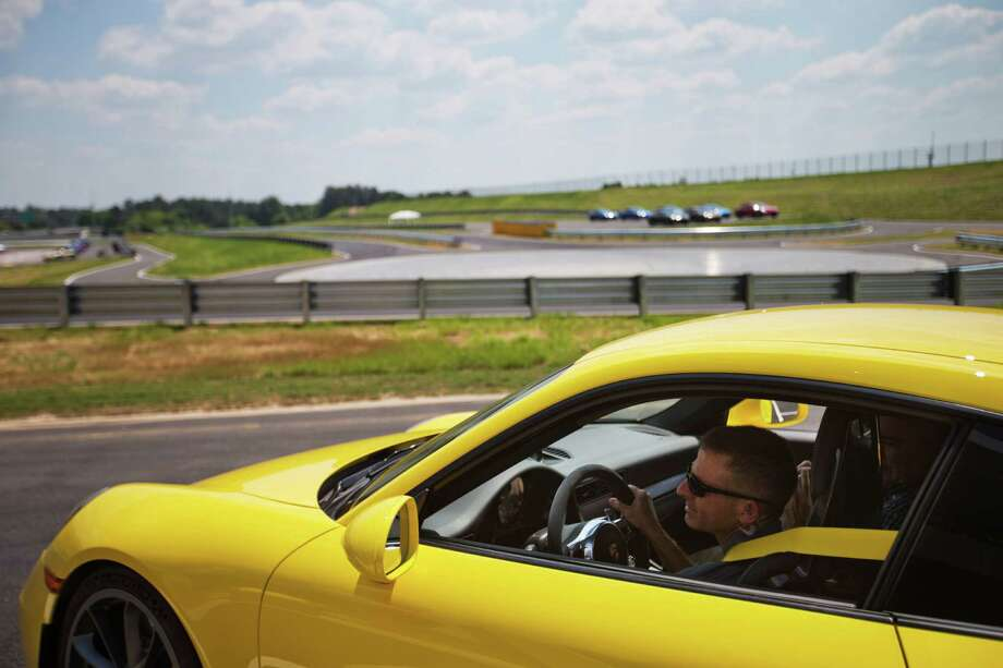 Brian Cunningham, chief instructor, drives a Porsche sports car through a development track at the company's North American headquarters, dubbed the Porsche Experience Center in Atlanta. Photo: David Goldman, STF / AP