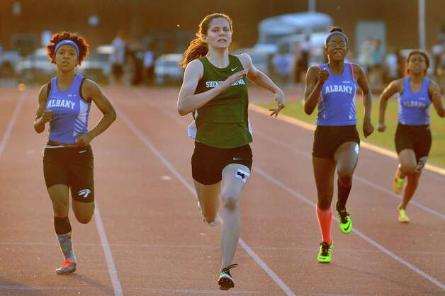 Shen's Alexandra Tudor, center, comes in first in the 200-meter run during the Shenendehowa Track Invitational on Friday, May 8, 2015, at Shenendehowa High in Clifton Park, N.Y. (Cindy Schultz / Times Union) Photo: Cindy Schultz / 00031760A