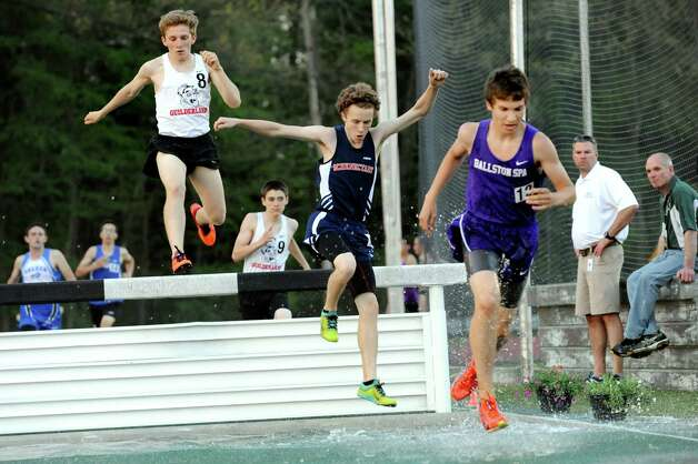Boys compete in the steeple chase during the Shenendehowa Track Invitational on Friday, May 8, 2015, at Shenendehowa High in Clifton Park, N.Y. (Cindy Schultz / Times Union) Photo: Cindy Schultz / 00031760A