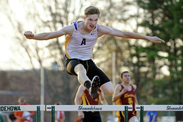 Amsterdam's Mike Johnson clears a hurdle in the 400-meter hurdles during the Shenendehowa Track Invitational on Friday, May 8, 2015, at Shenendehowa High in Clifton Park, N.Y. (Cindy Schultz / Times Union) Photo: Cindy Schultz / 00031760A