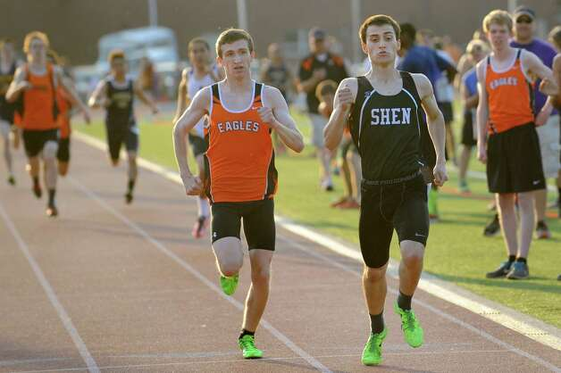 Shen's Jack Vite, right, takes first and Bethlehem's Simon Powhida, center, takes second in the second heat of the 800-meter run during the Shenendehowa Track Invitational on Friday, May 8, 2015, at Shenendehowa High in Clifton Park, N.Y. (Cindy Schultz / Times Union) Photo: Cindy Schultz / 00031760A