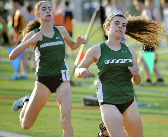 Shen's Caroline Rusch, right, and Ally Arserio take first and second, respectively, in the second heat of the 800-meter run during the Shenendehowa Track Invitational on Friday, May 8, 2015, at Shenendehowa High in Clifton Park, N.Y. (Cindy Schultz / Times Union) Photo: Cindy Schultz / 00031760A