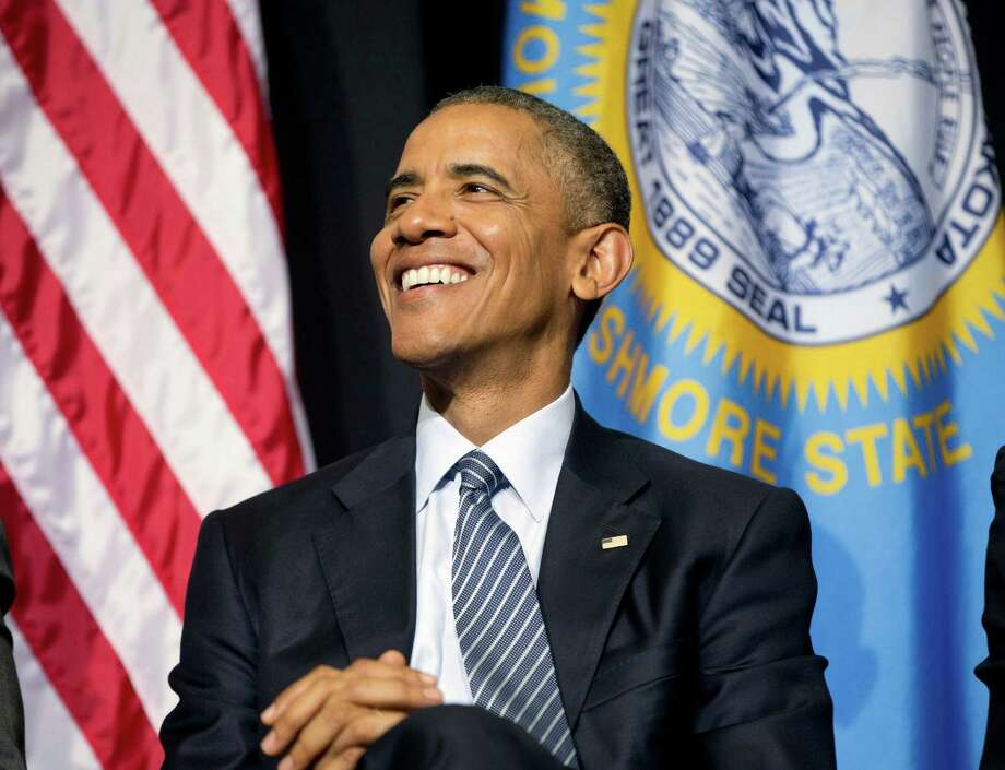 President Barack Obama smiles on stage as he waits to deliver the commencement address at Lake Area Technical Institute, Friday, May 8, 2015 in Watertown, S.D. Obama visited South Dakota to promote his proposal to offer two years for free community college to qualified students. (AP Photo/{Pablo Martinez Monsivais) Photo: Pablo Martinez Monsivais, STF / AP