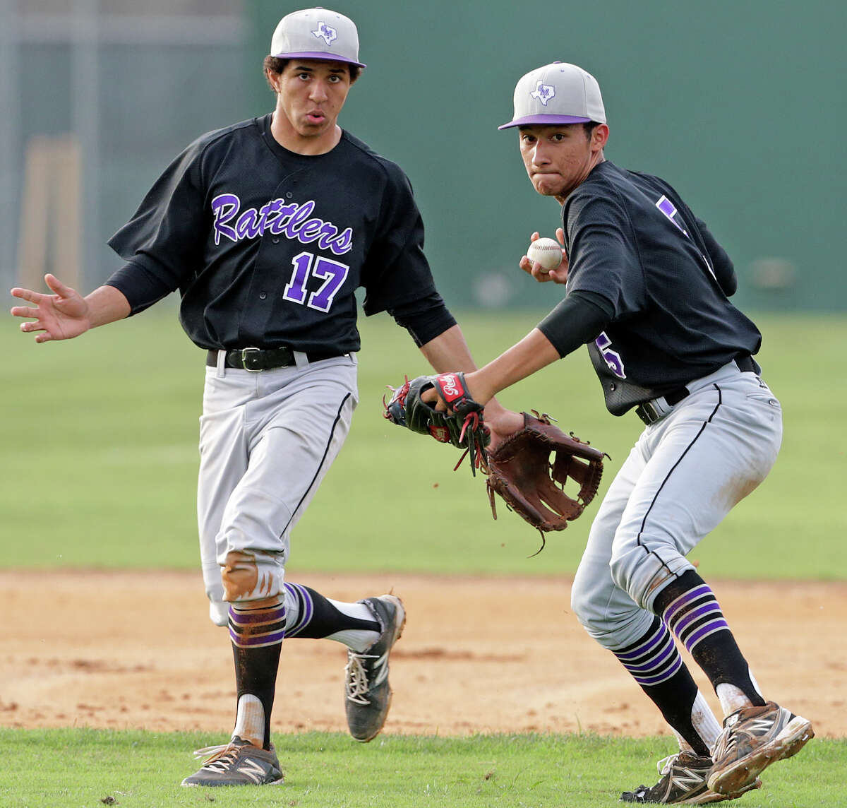 Rattler third baseman Brandon Miranda coils to fire to first with shortstop David Hamilton backing him up as McCollum hosts San Marcos in a 5A bidistrict baseball playoff series at Tejeda Sports Complex on May 8, 2015.
