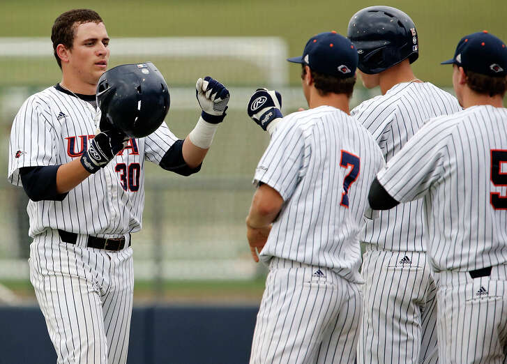 UTSA's Ben Brookover (left) celebrates with teammates after hitting a two-run homer against Middle Tennessee State during the third inning onMay 8, 2015 at Roadrunner Field on the UTSA campus.