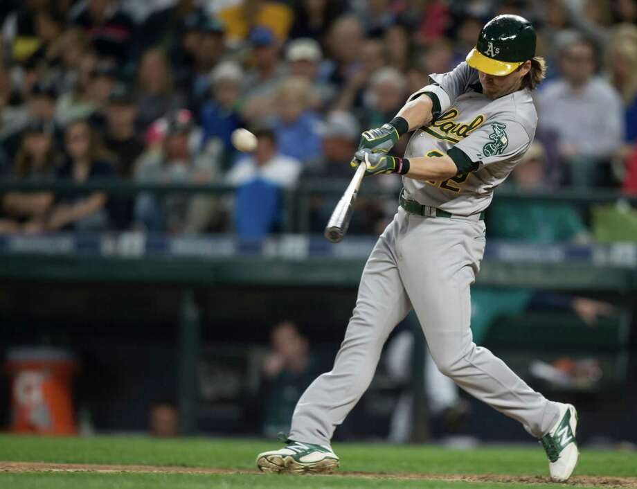 SEATTLE, WA - MAY 8: Josh Reddick #22 of the Oakland Athletics hits a two-run homerun that scored Sam Fuld #23 in the fifth inning of a game against the Seattle Mariners at Safeco Field on May 8, 2015 in Seattle, Washington. (Photo by Stephen Brashear/Getty Images) Photo: Stephen Brashear / Getty Images / 2015 Getty Images