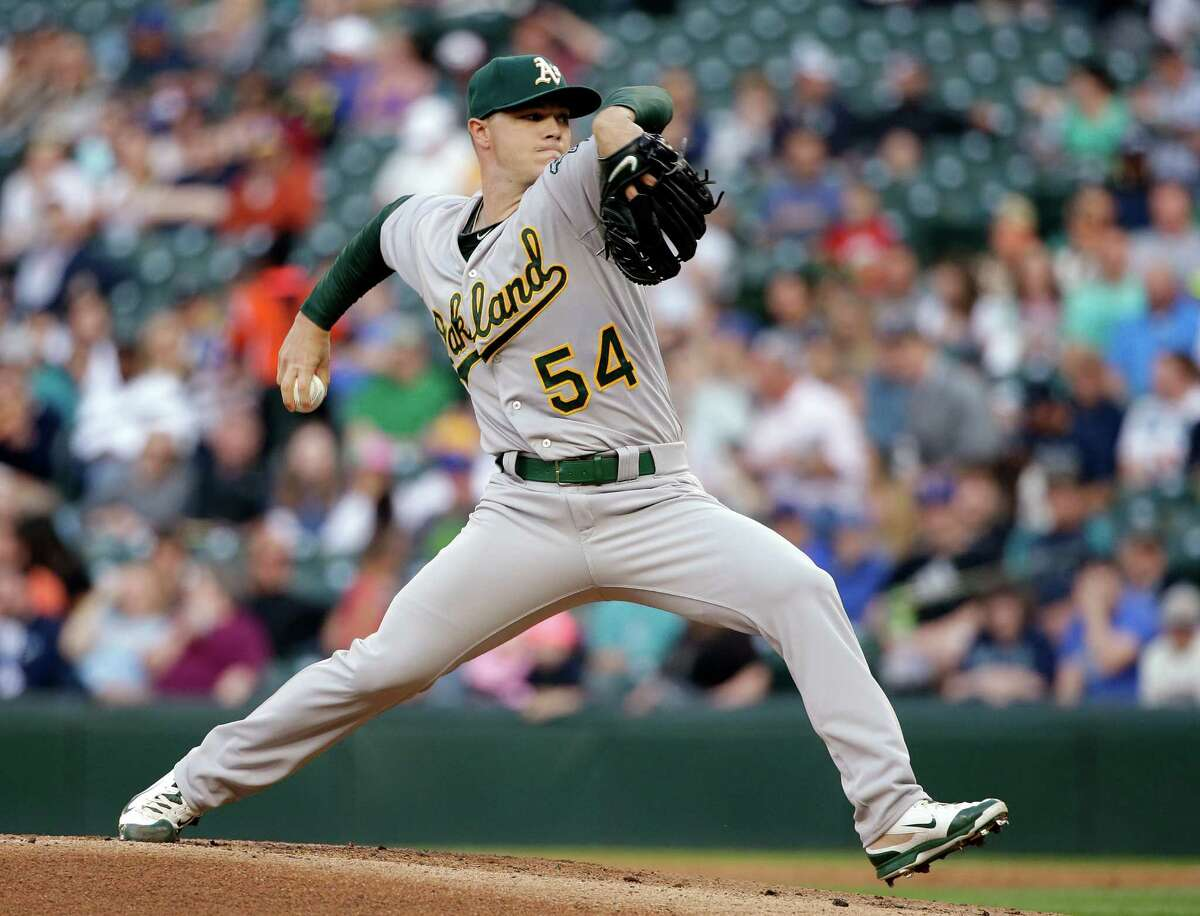 Oakland Athletics starting pitcher Sonny Gray throws against the Seattle Mariners in the first inning of a baseball game Friday, May 8, 2015, in Seattle. (AP Photo/Elaine Thompson)