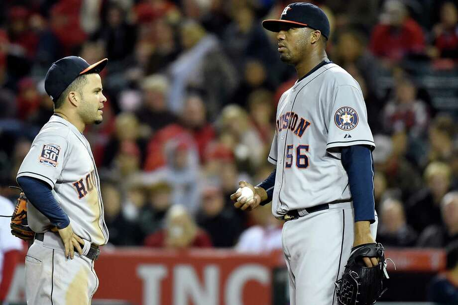 Roberto Hernandez and second baseman Jose Altuve discuss strategy in the eighth inning Friday in Los Angeles. Hernandez went 72⁄3 innings, allowing just two runs, but the Angels shut out the Astros 2-0. Photo: Lisa Blumenfeld, Stringer / 2015 Getty Images