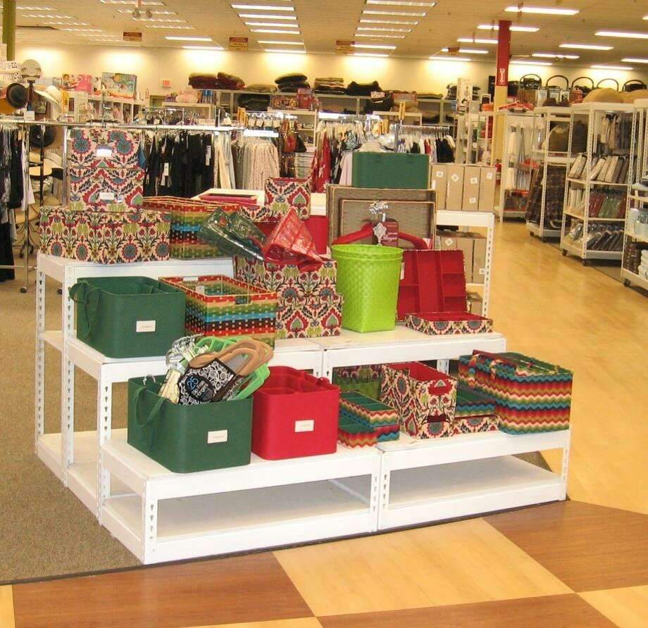 Tuesday Morning stores have a new look with signs that  point the way to areas that sell decorative home goods, furniture, kitchen items, bed and bath merchandise and more.