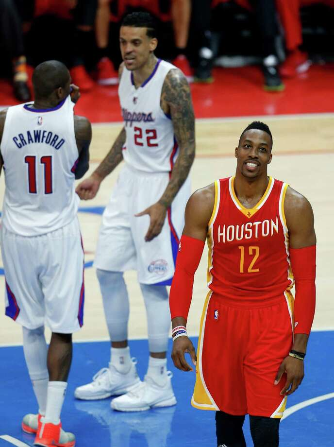 Rockets center Dwight Howard (12) shows his disappointment in the loss to the Clippers on Friday night at Staples Center. Howard had 14 points and 14 rebounds but did not score in the second half, and the Rockets trail the Clippers two games to one. Photo: Karen Warren, Staff / © 2015 Houston Chronicle