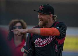 San Francisco Giants Hunter Pence points over to fans as he makes his way onto the field before his first rehab game for the Sacramento River Cats on Friday, May 8, 2015, at Raley Field in West Sacramento, California