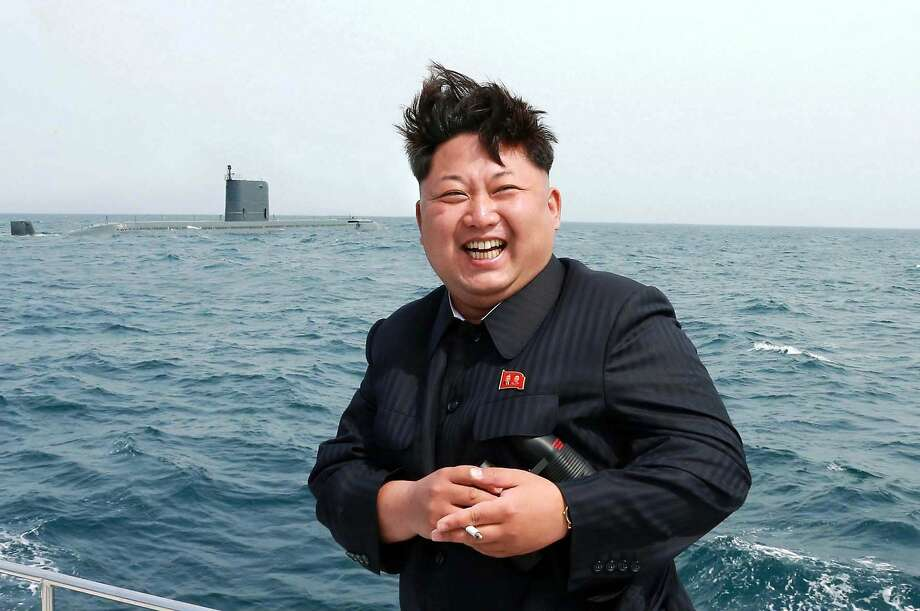 North Korean leader Kim Jong-Un enjoys observing an underwater test-fire of a submarine-launched ballistic missile in May. The Great Supreme Leader is quite the drinker, according to himself. More: photos of Kim looking at stuff. Photo: Kns, AFP / Getty Images