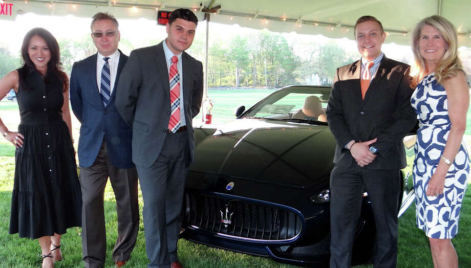 Kim Meier, far left, and Kim Heyn, both of Near & Far Aid, flank Maserati's Shima Fukano, Van Kolton and Rob Corbi, at the nonprofit group's Toast the Tour gathering at the Fairfield County Hunt Club. Photo: Mike Lauterborn / Westport News