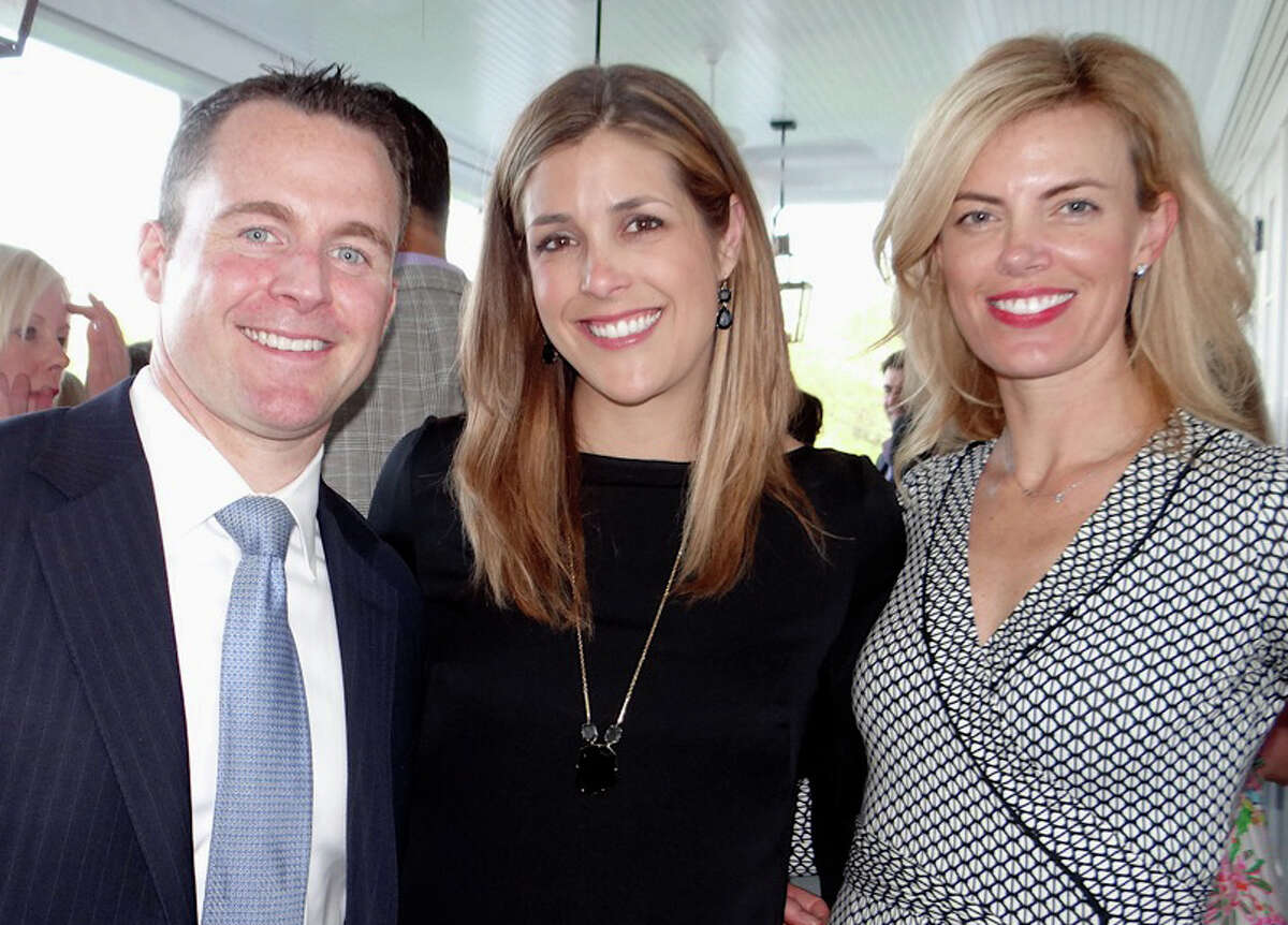Cameron and Beth Emmott with Katie Flaherty at Near & Far Aid's Toast the Tour gathering on Friday evening at the Fairfield County Hunt Club in Westport.