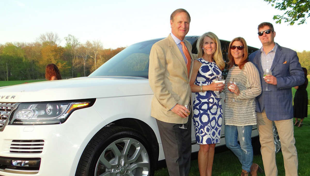 Chris and Kim Heyn with Nikki and Ryan Ambrifi, of Land Rover, at Near & Far Aid's Toast the Tour gathering at the Fairfield County Hunt Club in Westport.
