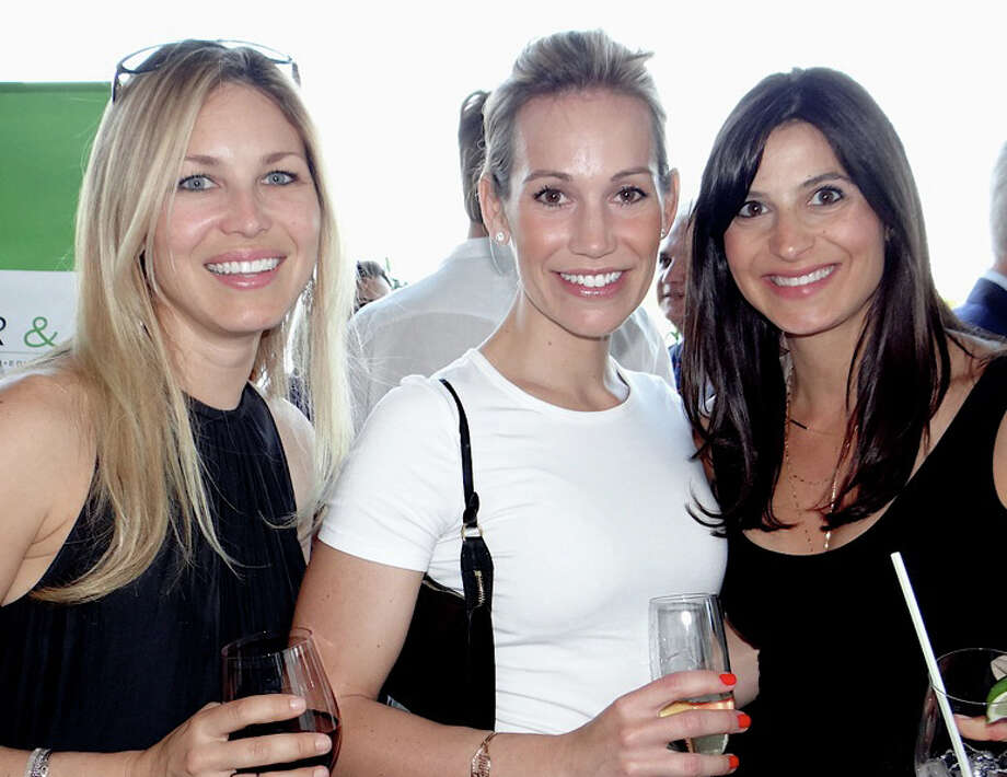 Kim Farnen, Christina Como and Vanessa Dembowski at Near & Far Aid's Toast the Tour gathering on Friday evening at the Fairfield County Hunt Club in Westport. Photo: Mike Lauterborn / Westport News