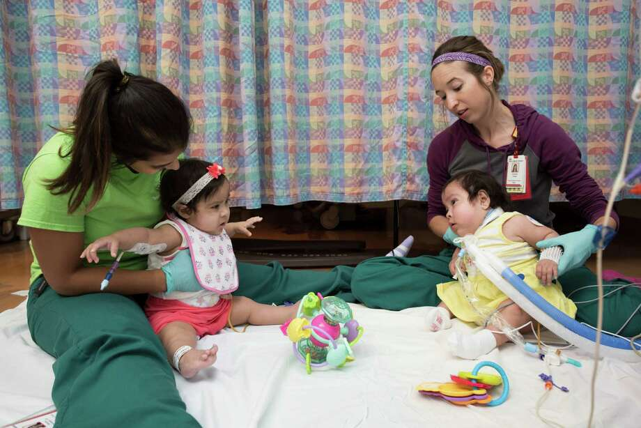 Knatalye Hope Mata is healthy enough to earn her release papers, but the Mata family will remain in Houston until Knatalye's sister, Adeline Faith, is able to go home, possibly in the next few months, according ot Texas Children's officials. Photo: Allen Kramer, Allen S. Kramer/Texas Children's Hospital / Texas Children's Hospital