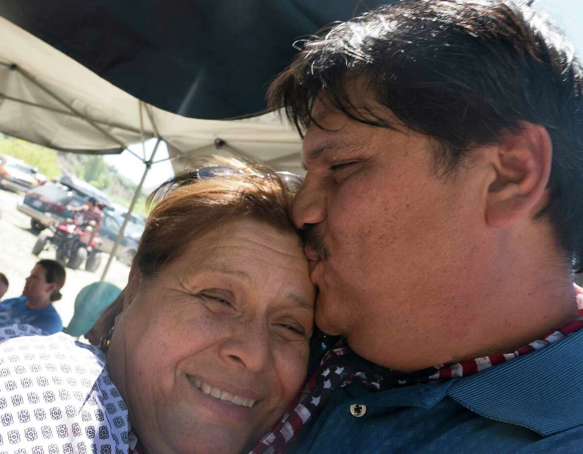 Yolanda Gonzalez, who was deported from the United States and had not seen her son, Anibal Pando, who lives in Pecos, Texas, in 11 years, gets a kiss from him after their reunion at the Voices From Both Sides festival held on the Rio Grande at Lajitas, Texas, on Saturday, May 9, 2015. Many people from Mexico and the United States gathered and in some cases reunited with family members that they have not seen for years because of the border.