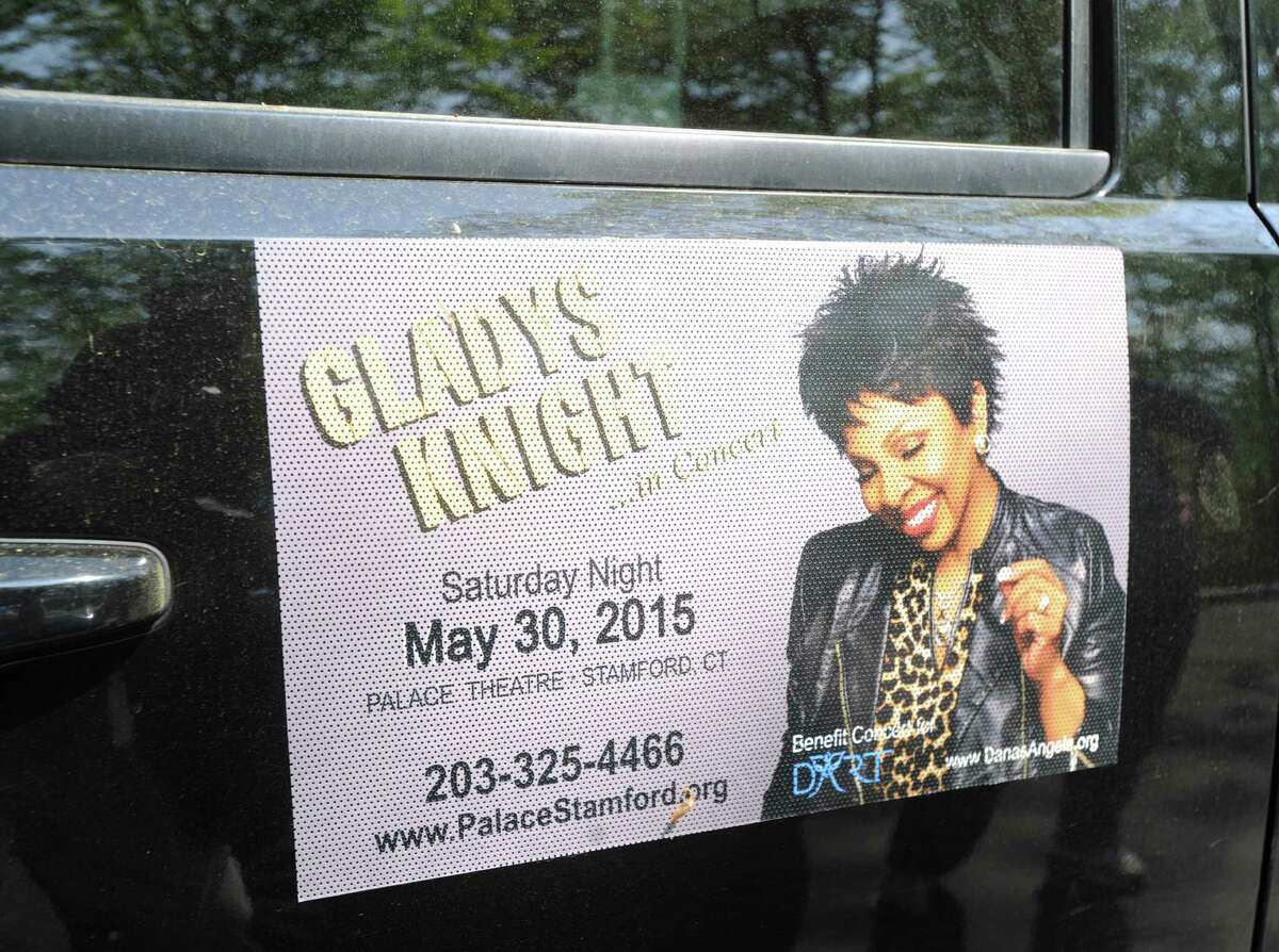 A Gladys Knight benefit poster on the side of a vehicle owned by Phil and Andrea Marella, husband and wife, at their Greenwich home, Friday, May 8, 2015. The Marella's son, Andrew, suffers from Niemann-Pick Type C, a genetic disease that is a neurodegenerative disorder which causes progressive deterioration of the nervous system. The family who also lost a daughter, Dana, to the disorder, is spearheading a benefit gala featuring Gladys Kinght at the Palace Theatre in Stamford on Saturday, May 30, to raise money and awareness for medical research of Niemann-Pick Type C.