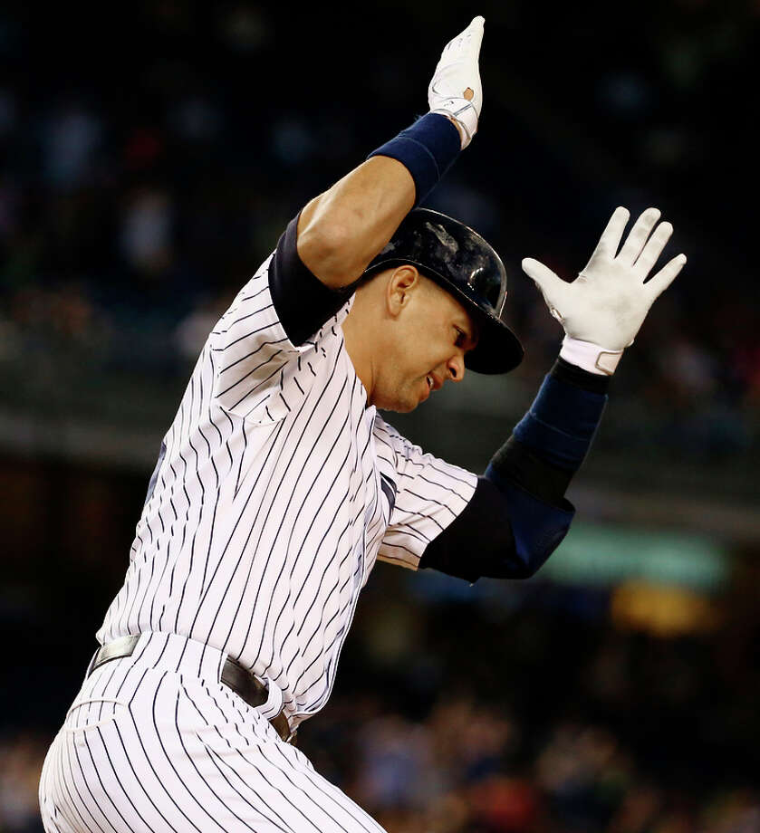 Alex Rodriguez celebrates the 661st home run of his career, passing Willie Mays, in Thursday's game. Photo: Al Bello / Getty Images / 2015 Getty Images